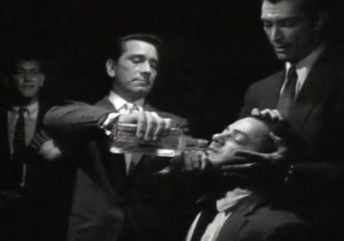 "Mr. Brown (Richard Conte) tortures Lt. Diamond (Cornel Wilde) in ""The Big Combo"" (1955)"