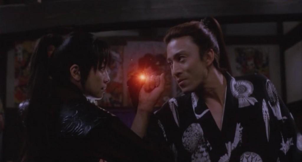 Rie Miyazawa and Somegorō Ichikawa in <em>Ashura</em> (2005)