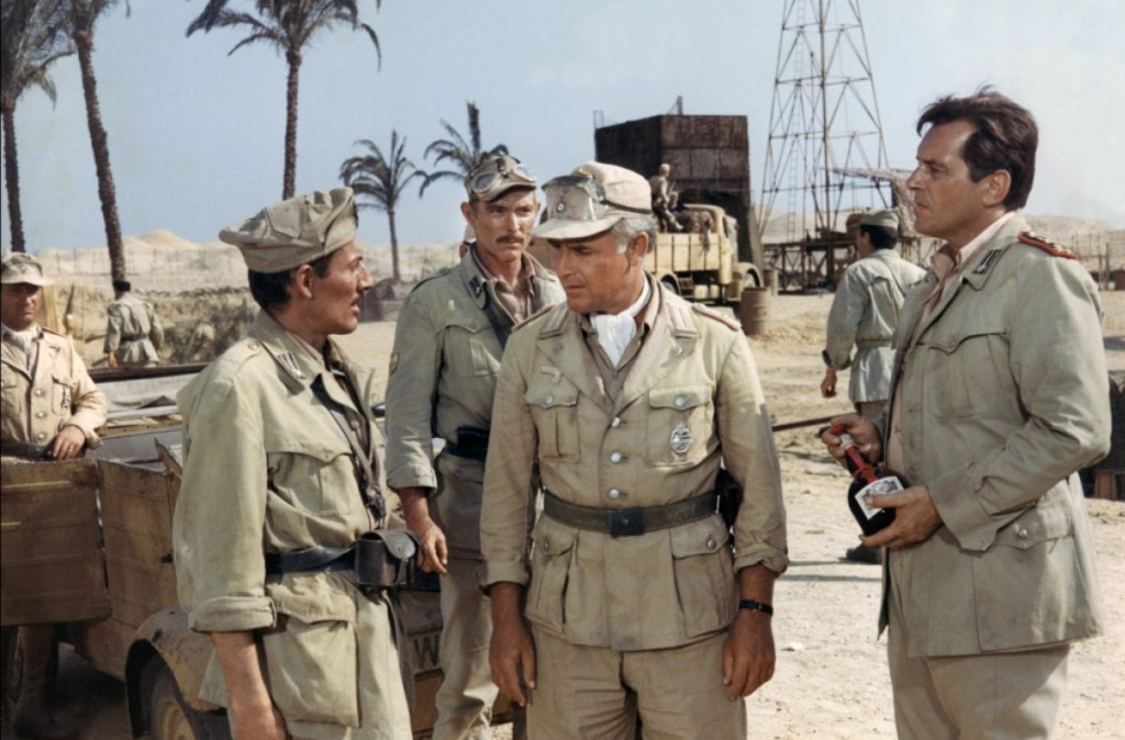 """Press Photo for """"Commandos"""" (1968) with Lee Van Cleef, Joachim Fuchsberger, and Jack Kelly"""